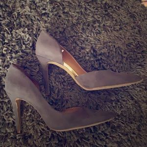 Gray high heels with gold trim.